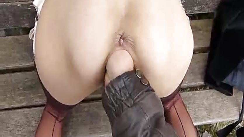 Blond milf brutally fisted at a public park