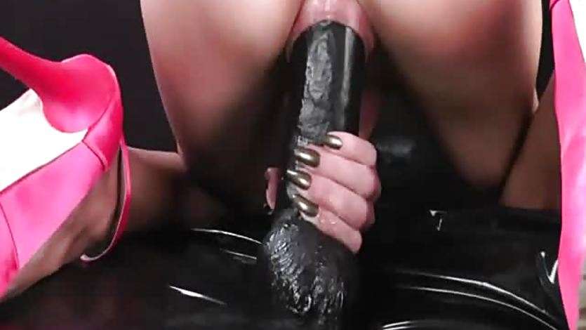 Busty brunette fisted and fucked with a huge dildo